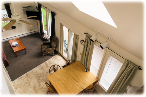 View of living area from lofted bedroom